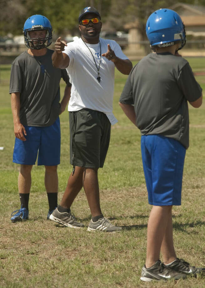 Trinity head coach Antwan Alexander works with his players during practice Tuesday. Tim Fischer\Reporter-Telegram Photo: Tim Fischer