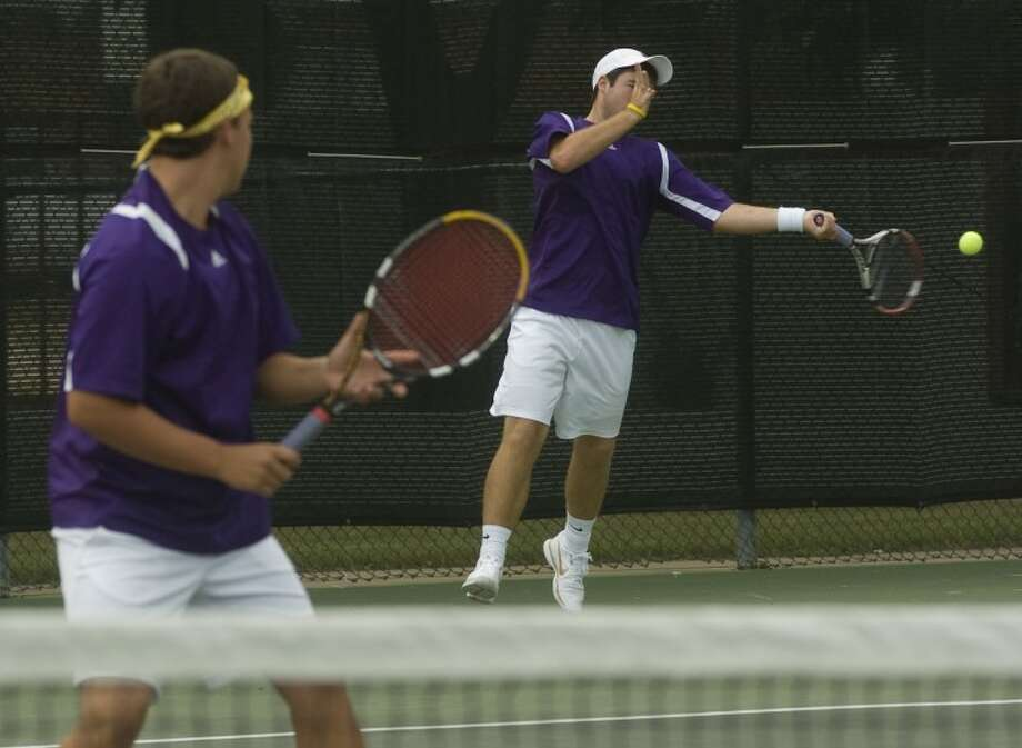 (File Photo) Zach Sivalls returns a shot as his doubles partner Ty Parkison watches Friday at the Petroplex Team Tennis Invitational. Photo by Tim Fischer/Midland Reporter-Telegram Photo: Tim Fischer