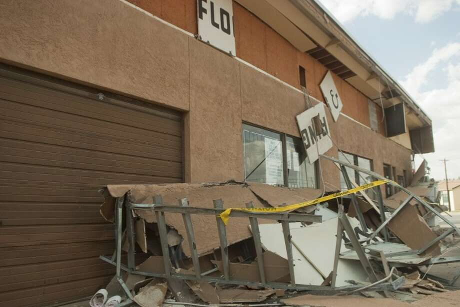 The front awning of Bill's Bottle Shop collapsed Monday afternoon. One customer was in the store at the time, but there weren't any injuries. Photo: Tim Fischer/Reporter-Telegram