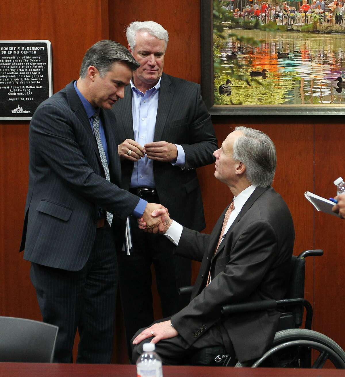Governor-elect Greg Abbott, right, shakes hands with State Rep. Roland Gutierrez, D-San Antonio, after meeting with area state lawmakers for a legislative roundtable discussion at the San Antonio Chamber of Commerce, Monday, Dec. 15, 2014. Behind them is Rep. Lyle Larson, R-San Antonio. Also at the meeting were San Antonio Democratic representatives Trey Martinez Fischer and Justin Rodriguez.