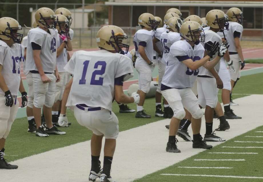 Midland High players run drills Friday evening during the first day to practice in pads. Photo by Tim Fischer\ Reporter-Telegram Photo: Tim Fischer