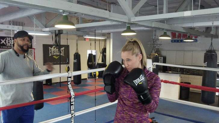 Boxer Virginia Fuchs works out under the eye of trainer Derwin Richards.