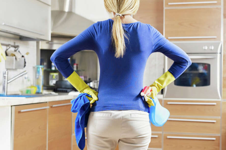 woman doing housekeeping Photo: Diego Cervo / iStockphoto