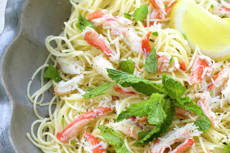 This May 2, 2011 photo shows angel hair pasta with crabmeat, jalapeno and mint in Concord, N.H. Chef Jonathan Waxman, of the New York restaurant Barbuto, says freshly cooked crab is essential for this recipe. (AP Photo/Matthew Mead) Photo: Matthew Mead / ap