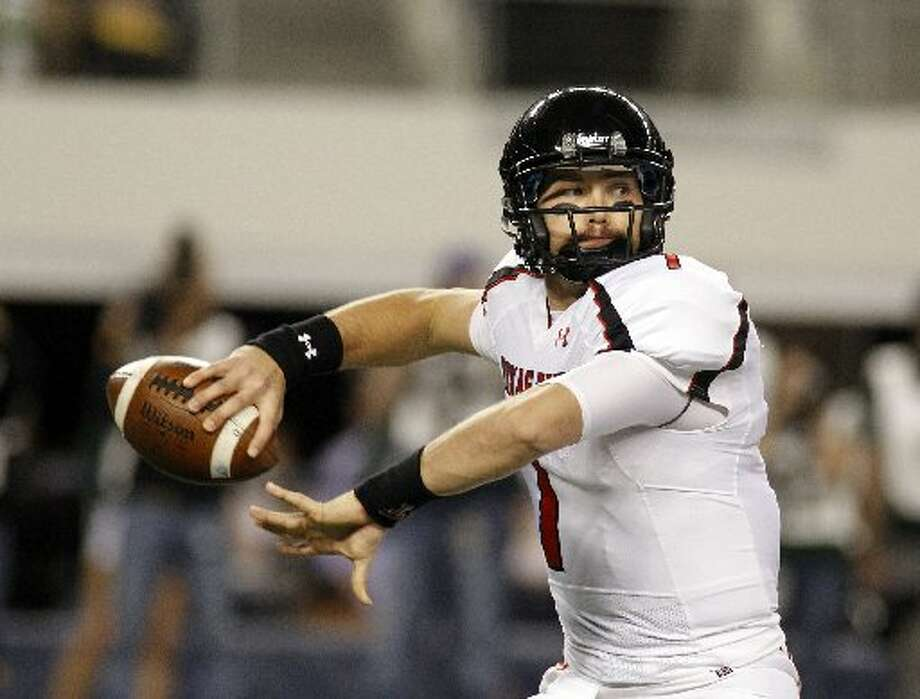 Texas Tech quarterback Seth Doege throws a pass in the first half of an NCAA football game in 2011. Doege says he's ready to show fans the Red Raiders are back. Texas Tech opens its season at home on Sept. 1 against Northwestern State. Photo: Associated Press