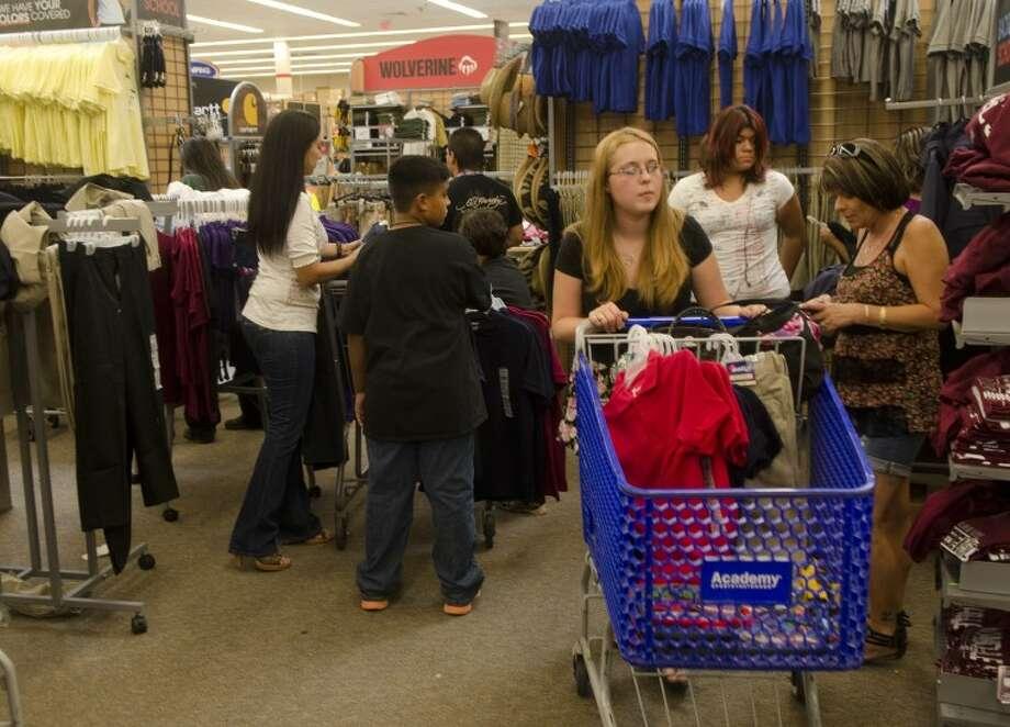 (File Photo) Shoppers make their way through the school uniform area Friday at Academy. Photo by Tim Fischer\ Reporter-Telegram Photo: Tim Fischer