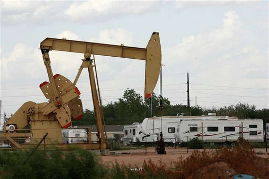 (FILE PHOTO) In this July 25, 2012 photo, an RV park is located near a pump jack in Midland, Texas. The oil and gas boom in the Permian Basin has driven up demand for housing and services. (AP Photo/San Antonio Express-News, Jerry Lara) Photo: Jerry Lara / San Antonio Express-News