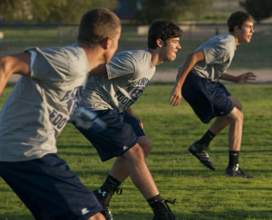 Greenwood players run drills Monday morning on the first day of practice. Tim Fischer\Reporter-Telegram Photo: Tim Fischer