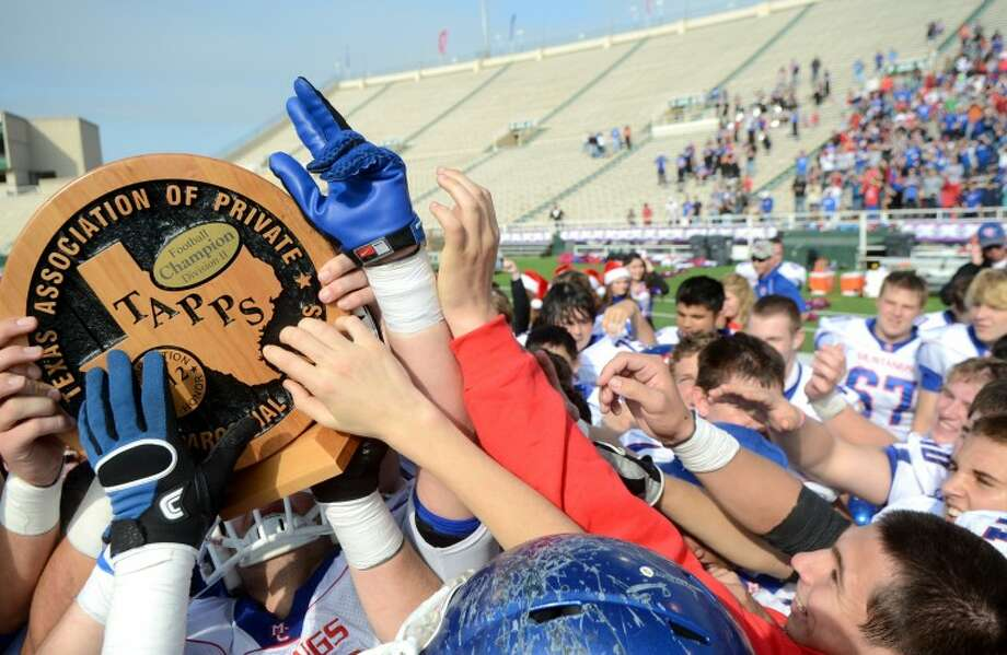 The Midland Christian football team celebrates with the TAPPS Division II State Championship game trophy Saturday after beating Houston Northland 14-7 at Floyd Casey Stadium in Waco, Texas. James Durbin/Reporter-Telegram Photo: JAMES DURBIN
