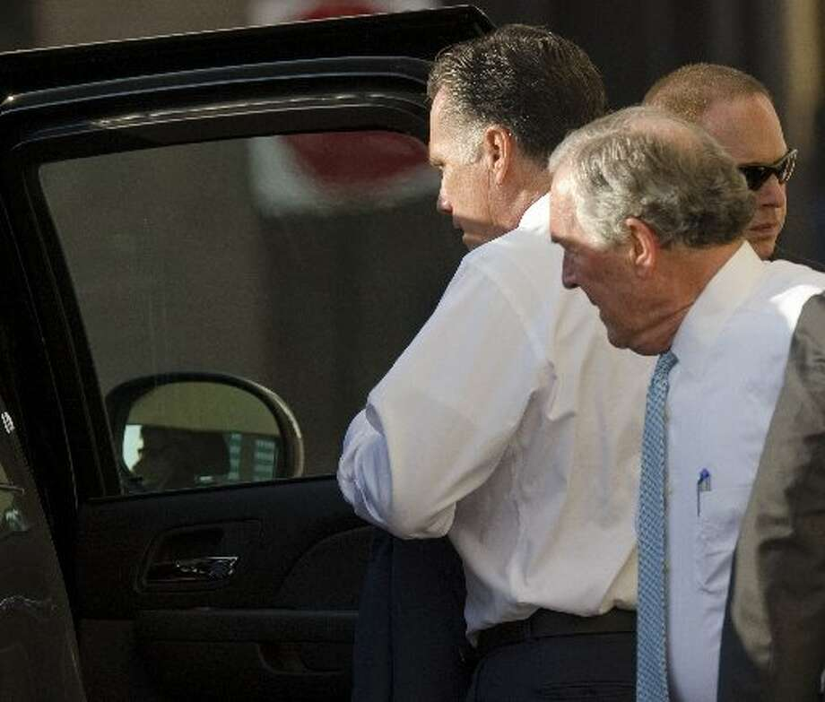 Gov. Mitt Romney gets back into his car after a fundraising event at the Petroleum Club. Midlander Don Evans, at right, was traveling with the presidential candidate. Photo: Tim Fischer/Reporter-Telegram