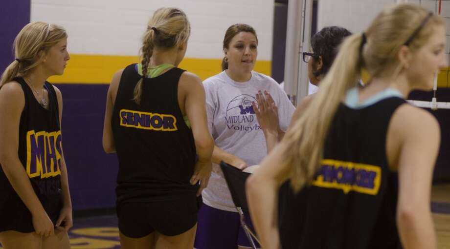 Midland High volleyball coach Amanda Lopez talks with players on Aug. 6 during practice. Photo by Tim Fischer\ Reporter-Telegram Photo: Tim Fischer