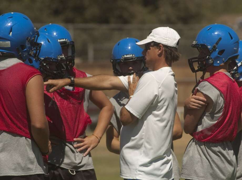 Trinity coach Chris Jauz works with his players during practice Tuesday morning. Photo by Tim Fischer/Midland Reporter-Telegram Photo: Tim Fischer