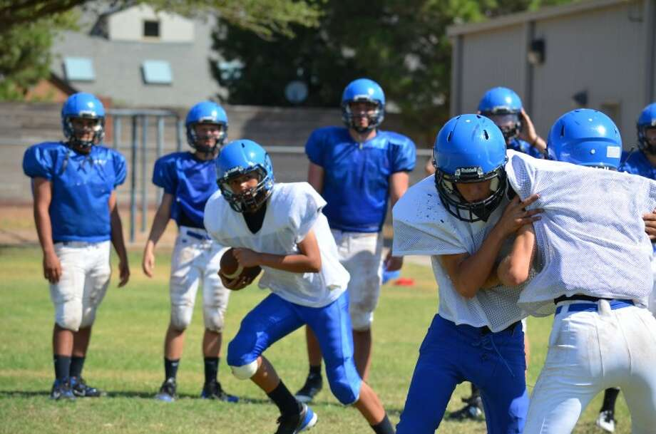 Trinity High School football athletes drill Thursday morning in preperation for the upcoming season. Photo: James Cannon