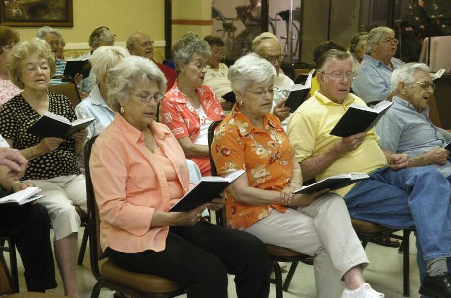 (File Photo) Seniors sing gospel hyms at the Midland Senior Center. Photo by Tim Fischer 6/12/08 Photo: Midland
