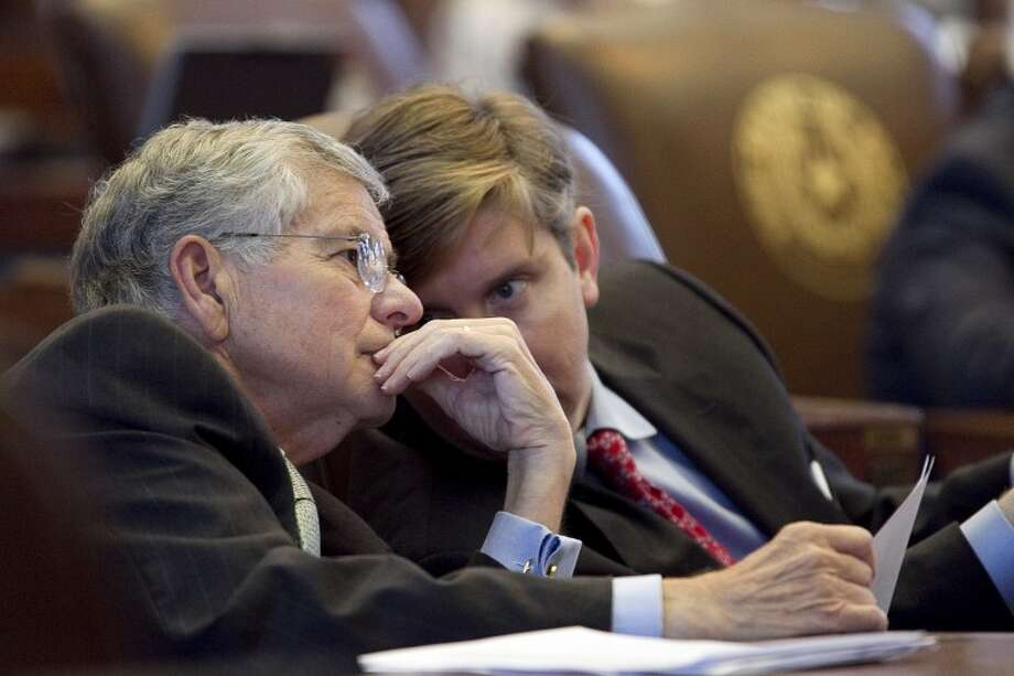 Rep. Tom Craddick talks with to Rep. Tan Parker, right, during a speech by Rep. David Simpson (not shown) at the Capitol in Austin, Texas, on Wednesday, June 29, 2011. (AP Photo/Austin American-Statesman, Deborah Cannon) MAGS OUT; NO SALES; TV OUT; INTERNET OUT; AP MEMBERS ONLY; MANDATORY CREDIT Photo: Deborah Cannon