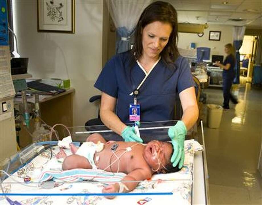 Nurse Monica Carter tends to JaMichael Brown who was born at Good Shepherd Medical Center Friday, July 8, 2011, weighing more than 16 lbs. Photo: (Les Hassell/News-Journal Photo)