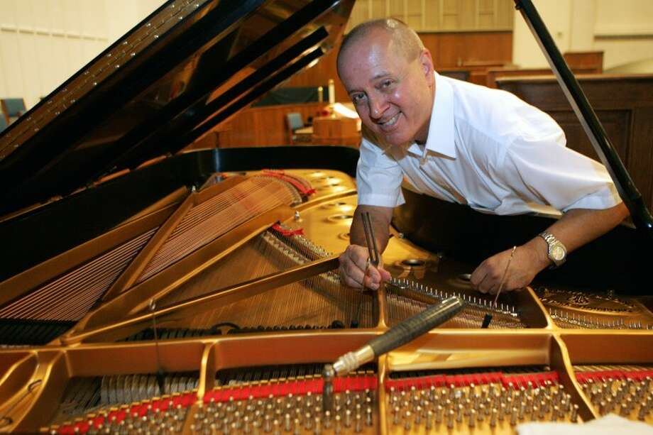 Mike Sherrod is one of three piano tuners in the area who can make instruments, like this Grand Piano at United Methodist Church, sound their best when played. Cindeka Nealy/Reporter-Telegram Photo: Cindeka Nealy