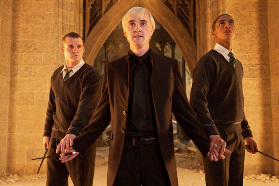 "In this film publicity image released by Warner Bros. Pictures, from left, Josh Herdman portrays Gregory Goyle, Tom Felton portrays Draco Malfoy and Louis Cordice portrays Blaise Zabini in a scene from ""Harry Potter and the Deathly Hallows: Part 2."" Photo: (AP Photo/Warner Bros. Pictures, Jaap Buitendijk) / (C) 2011 WARNER BROS. ENTERTAINMENT INC. HARRY POTTER PUBLISHING RIGHTS (C) J.K.R.  HARRY POTTER CHARACTERS, NAMES AND RELATED INDICIA ARE TRADEMARKS OF AND (C) WARNER BROS. ENT.  ALL RIGHTS RESERVED"