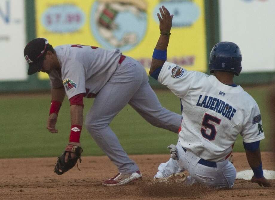 Springfield's Jose Garcia stretches to get the force out at second as RockHounds' Tyler Ladendorf slides earlier this season at CitiBank Ballpark. The RockHounds lost to Springfield, 13-3, on Tuesday night in Springfield, Mo. Photo by Tim Fischer/Midland Reporter-Telegram Photo: Tim Fischer