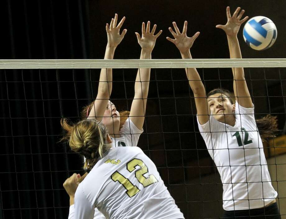 Midland defenders Kristina Gafford (left) and Megan Sanchez (right) block against the Temple College offense during the 2012 Midland College Kick-Off Volleyball Classic Friday at the Chaparral Center. James Durbin / For the Reporter-Telegram Photo: JAMES DURBIN