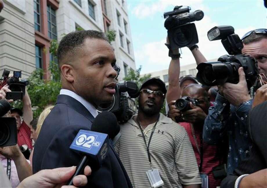 Former Illinois Rep. Jesse Jackson Jr., leaves federal court in Washington, Wednesday, Aug. 14, 2013. Jackson was sentenced to two and a half years in prison Wednesday after pleading guilty to scheming to spend $750,000 in campaign funds on TV's, restaurant dinners, an expensive watch and other costly personal items. His wife received a sentence of one year. (AP Photo/Susan Walsh) Photo: Susan Walsh / AP