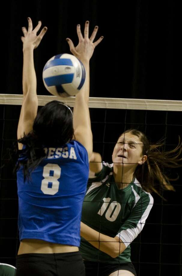 Midland College's Dragana Cvoric spikes the ball through the arms of Odessa College's Emily Bushard last season at Chaparral Center. Photo by Tim Fischer/Midland Reporter-Telegram Photo: Tim Fischer