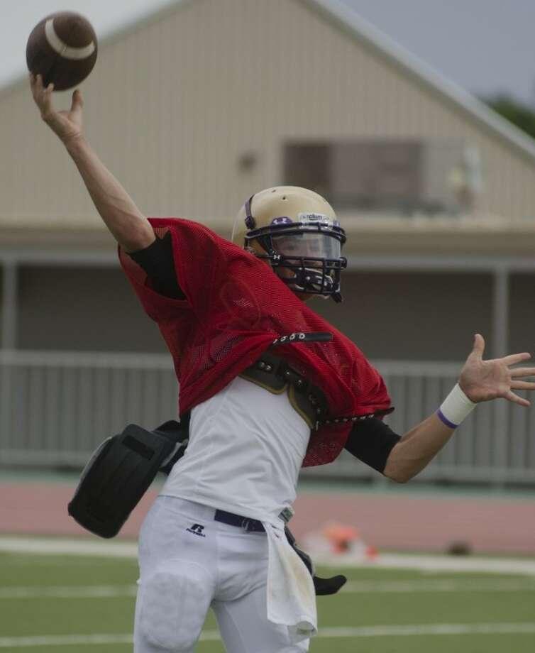 Midland High qb Connor Beck warms up Aug. 17 at practice. Photo by Tim Fischer\ Reporter-Telegram Photo: Tim Fischer