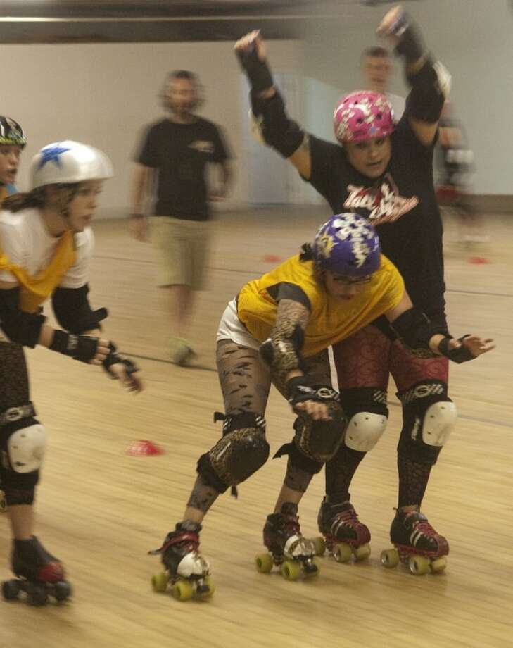 Women collide during roller derby practice Thrsdy evening in Odessa. Photo by Tim Fischer/Midland Reporter-Telegram Photo: Tim Fischer