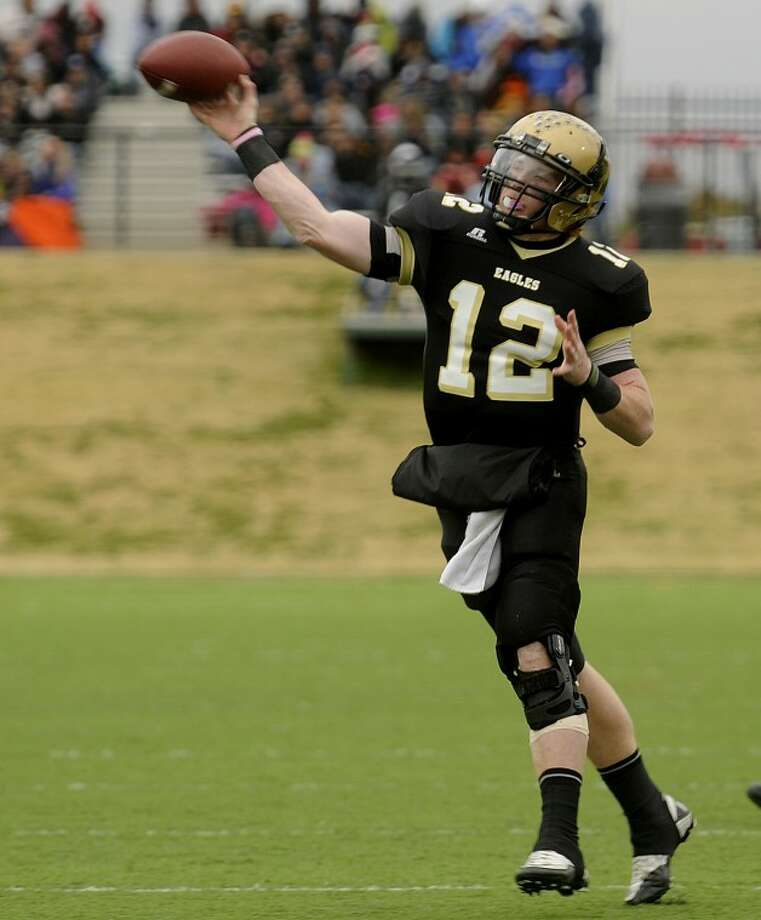 Thomas Metthe/Reporter-News Abilene High quarterback Evin Abbe (12) throws a pass during the first quarter of the Eagles' 25-22 win over Mansfield High in the Region I-5A Division II regional round playoff game on Saturday, Nov. 26, 2011, at Shotwell Stadium. Photo: Tommy Metthe