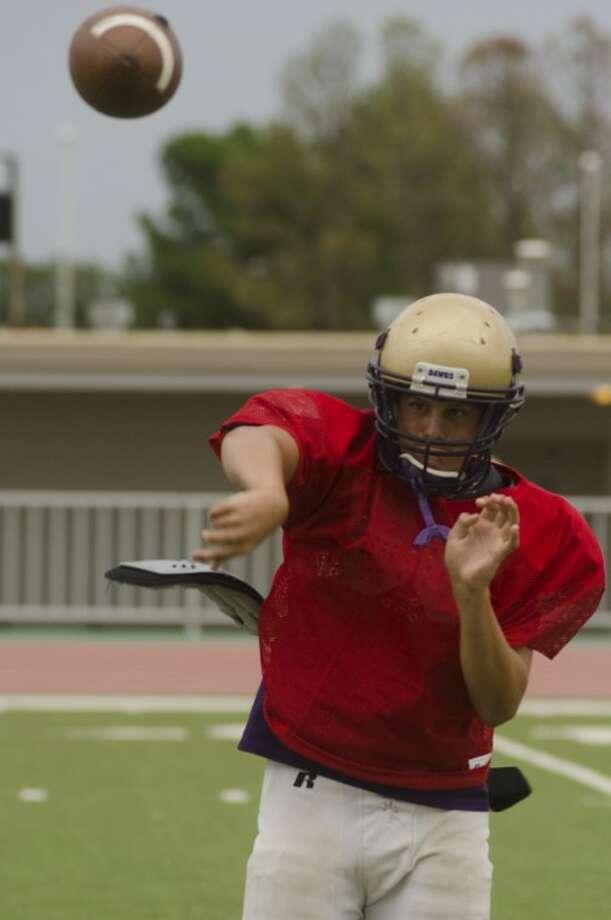 Midland High qb Sam Grimes warms up Aug. 17 at practice. Photo by Tim Fischer\ Reporter-Telegram Photo: Tim Fischer