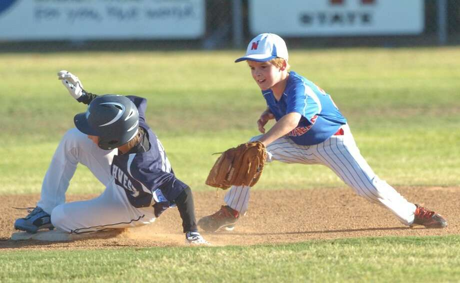 Southwest Little Leagues Sudden Saipien (7) slides onto second-base as Northern Little League short-stop Jaxson Bayley (21) attempts the tag Wednesday during their 9-10 year-old Championship All-Stars game at Bluebird Park. Cindeka Nealy/Reporter-Telegram Photo: Cindeka Nealy