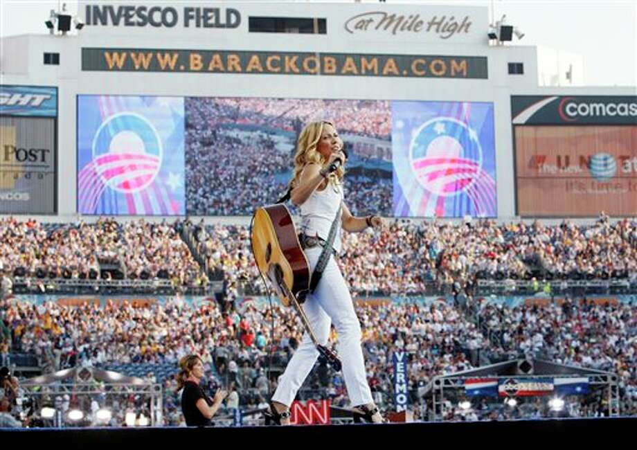 FILE - In this Aug. 28, 2008 file photo, singer Sheryl Crow performs on the last day of the Democratic National Convention at Invesco Field in Denver. Fewer celebrities is an emerging theme for the Democratic Convention this year. (AP Photo/Charles Dharapak) Photo: Charles Dharapak / AP