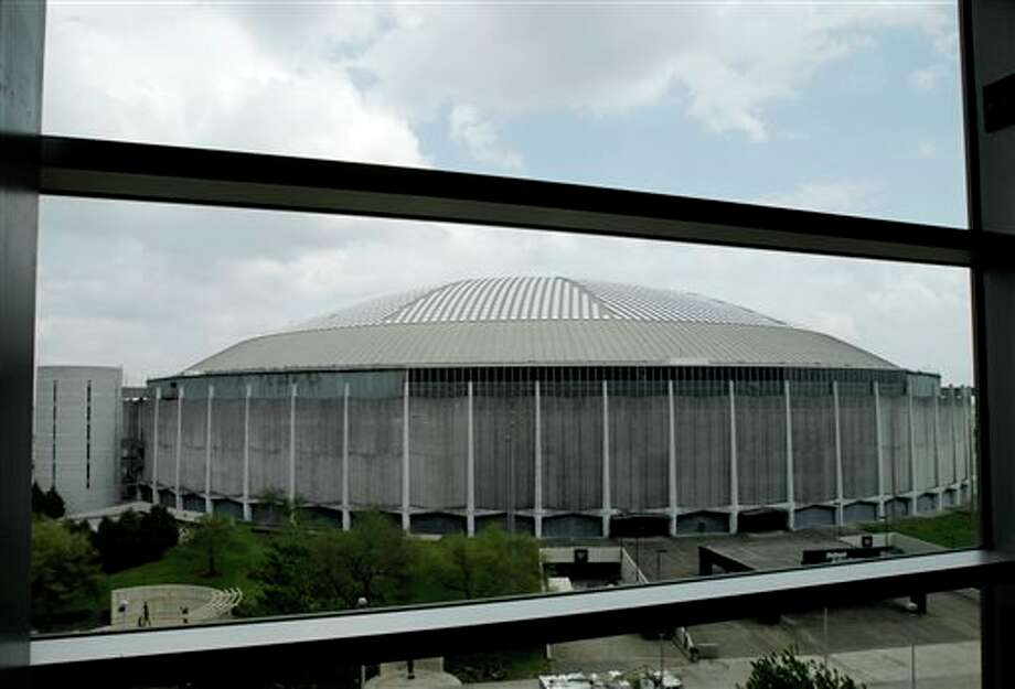 "File -In this March 25, 2011 file photo, Houston's Astrodome, once called ""The Eighth Wonder of the World,"" is seen through the windows of the Club Level of Reliant Stadium. The fate of a plan to renovate the iconic stadium that's fallen into disrepair since it was shuttered four years ago, will be in the hands of voters this fall. Harris County commissioners on Tuesday approved placing a measure on the Nov. 5 ballot that will ask voters to authorize up to $217 million in bonds to pay for a plan to turn the stadium into a giant convention center and exhibition space. (AP Photo/Pat Sullivan, File) Photo: Pat Sullivan / AP"