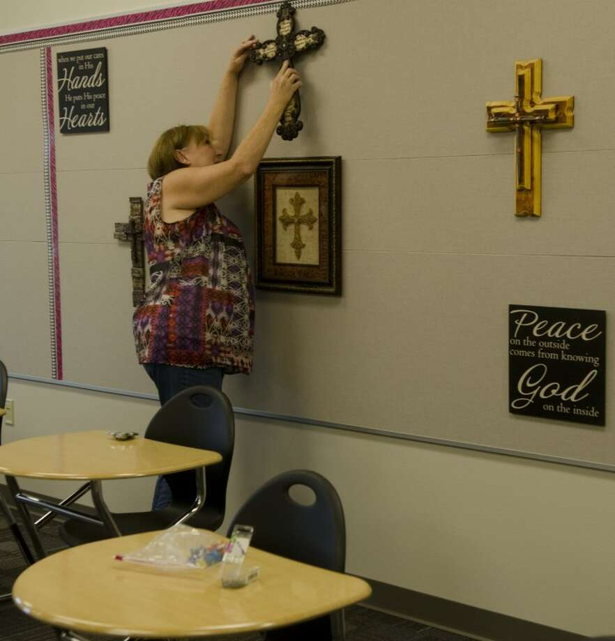 Connie Howell, MCS High School English teacher, decorates her new room in the Thursday morning. Photo by Tim Fischer\ Reporter-Telegram Photo: Tim Fischer