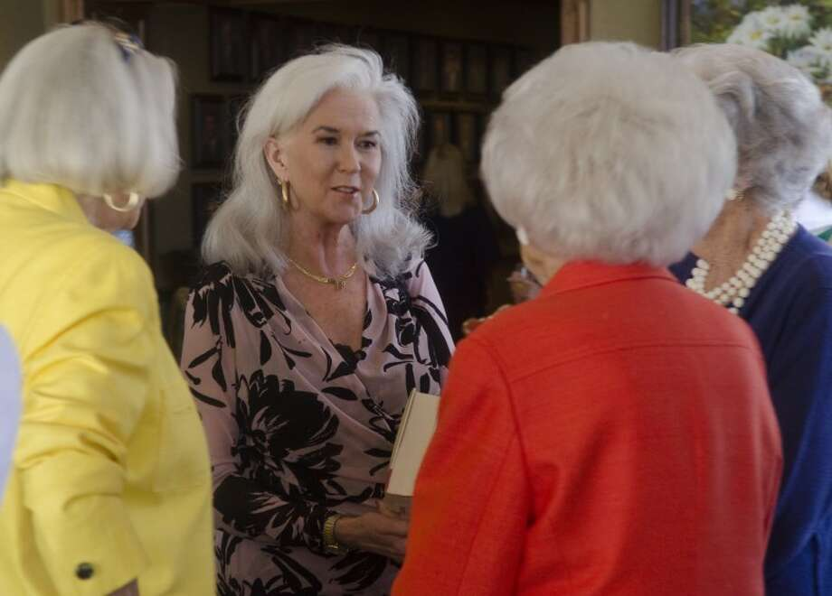 Columnist Heloise of Hints from Heloise, laughs and talks with Sally Reeder, RoseAnn Hughston and Carolyn Roden Tuesday before at luncheon benefiting Meals on Wheels. Tim Fischer/Reporter-Telegram Photo: Tim Fischer