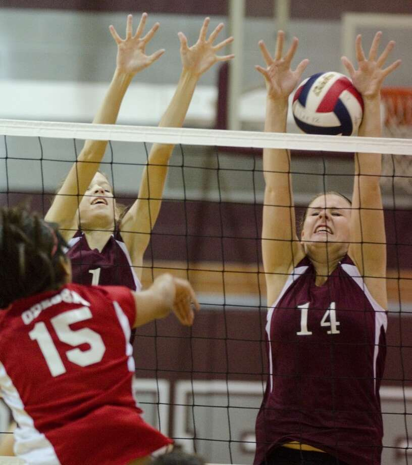 Odessa High's Viviana Avalos gets the ball past Lee's Tessa Bane, 14 and Stephanie Brewer, 1, Aug. 27 at LHS. Tim Fischer/Reporter-Telegram Photo: Tim Fischer