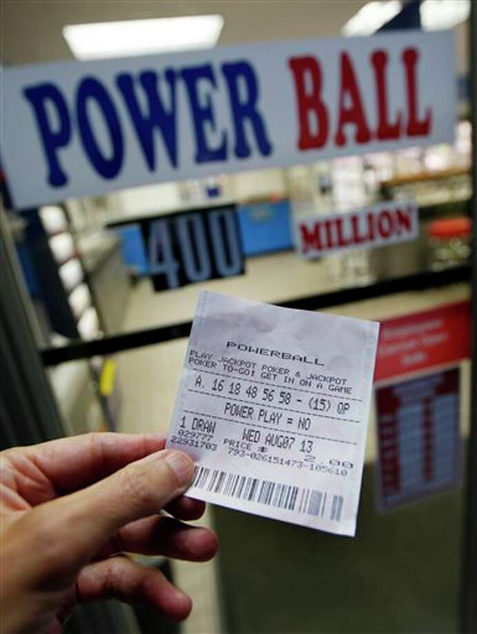 A person holds a Powerball ticket outside Ted's Mobil Mart in Methuen, Mass., Tuesday, Aug. 6, 2013. As of Tuesday, the estimated jackpot is $400 million. (AP Photo/Elise Amendola) Photo: Elise Amendola / AP