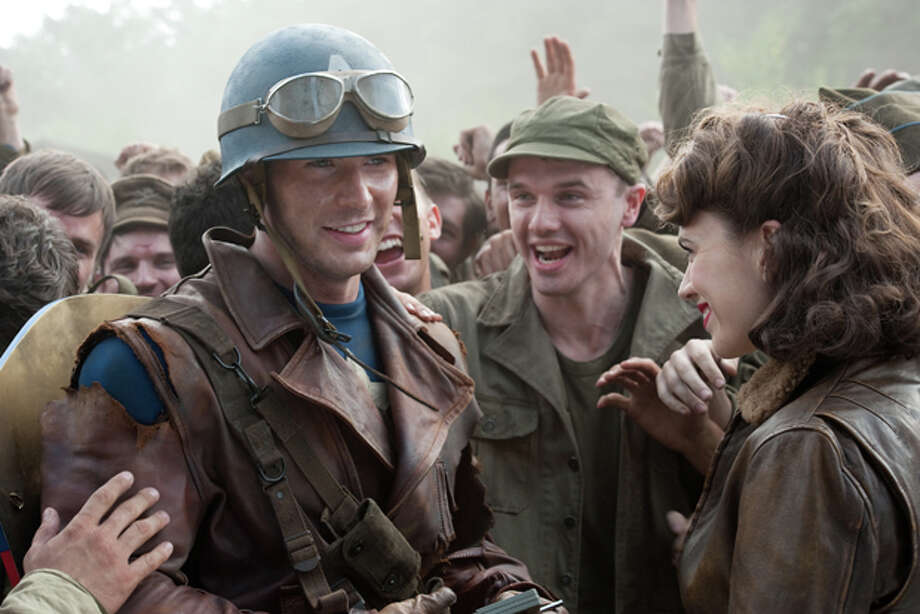 """In this film publicity image released by Paramount Pictures, Hayley Atwell portrays Peggy Carter, right, and Chris Evans portrays Steve Rogers in a scene from the film """"Captain America: The First Avenger."""" (AP Photo/Paramount Pictures, Jay Maidment) Photo: Jay Maidment / © 2011 MVLFFLLC. TM & © 2011 Marvel. All Rights Reserved."""