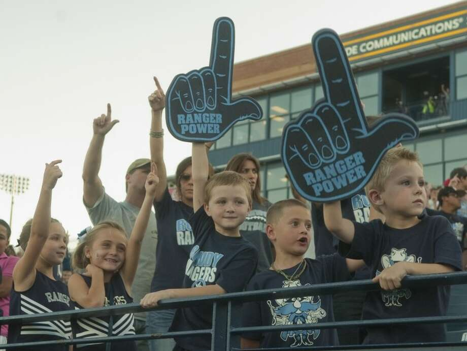 Greenwood Range fans show their guns up during the school song Thursday night as the rangers get ready to take on Kermit in the ASCO Midland Football Madness at Grande Communication Stadium. Tim Fischer/Reporter-Telegram Photo: Tim Fischer