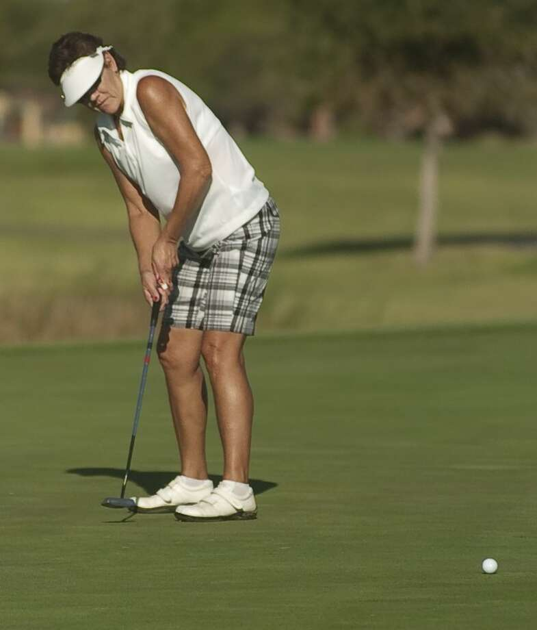 Bev Wright watches her putt Monday as she and others play in the Women's City Golf Tournament qualifier at Greentree Country Club. Photo by Tim Fischer/Midland Reporter-Telegram Photo: Tim Fischer