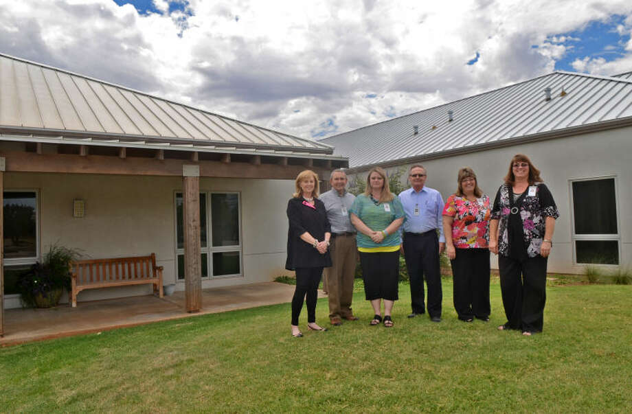 Springboard Center employees from left, Kathy Fletcher, marketing and development director; Dr. Dennis Shaughnessy, medical director; Jalain Bagley, finance department; Steven Hart, clinical director; Tammy Ross, executive director; and Deonne Presley, administrative assistant, stand outside the new wing of the Springboard Center on Wednesday. James Durbin/Reporter-Telegram Photo: JAMES DURBIN
