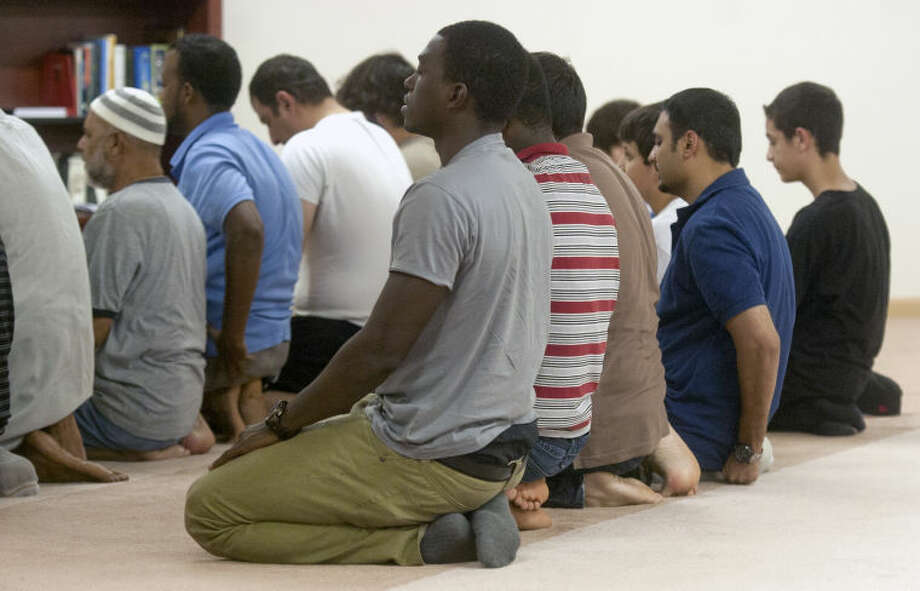 Members of the Muslim Association of West Texas pray after breaking their fast with a potluck dinner Aug. 2. James Durbin/Reporter-Telegram Photo: JAMES DURBIN