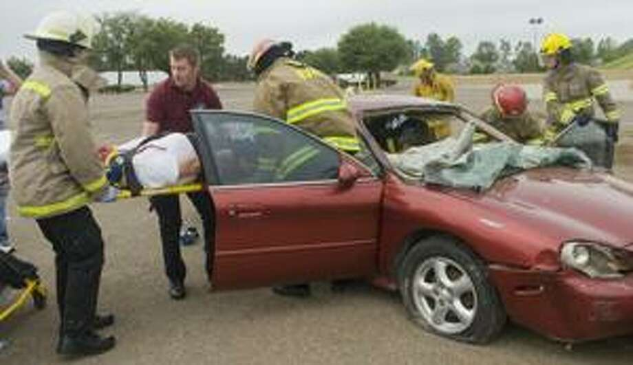 "In this April 2010 file photo, Midland College EMT and firefighters practice responding to a crash during a mock drill on campus. The EMT and paramedic programs will participate in a ""Rural Resuce Day"" Saturday near Martin County on Highway 349. Photo by Tim Fischer/Midland Reporter-Telegram Photo: Tim Fischer / Midland"