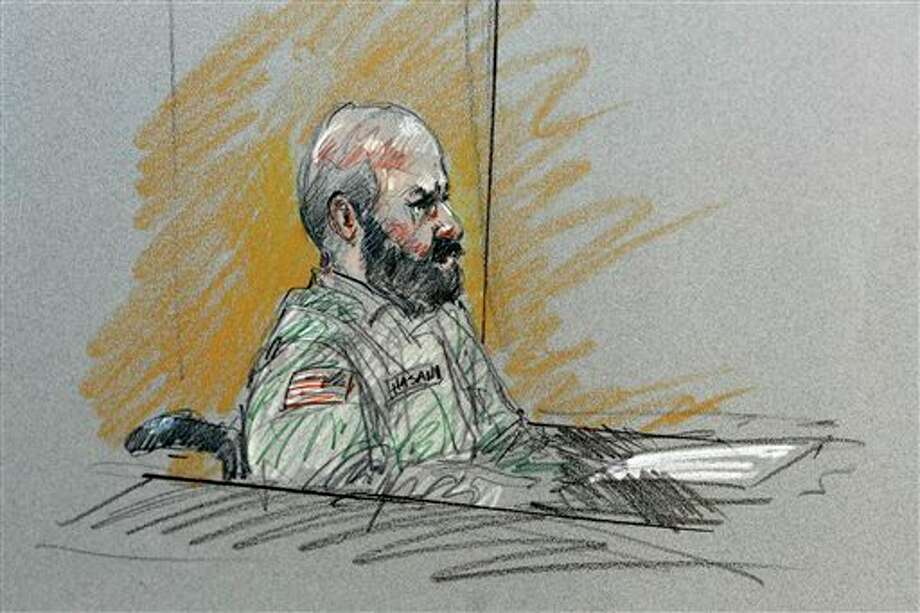 RE-TRANS FOR TONING AND CAPTION IMPROVEMENTS - In this courtroom sketch, Maj. Nidal Malik Hasan sits in court for his court-martial Tuesday, Aug. 6, 2013, in Forth Hood, Texas. Hasan is representing himself against charges of murder and attempted murder for the 2009 attack that left 13 people dead at Forth Hood. (AP Photo/Brigitte Woosley) Photo: Brigitte Woosley / AP