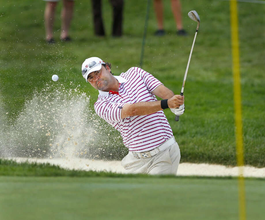 Midland's Lee Rhind hits out of a bunker on 12 during first round action at Oak Hill in Pittsford Thursday, August 8, 2013. (Photo by Kris J. Murante / Former Midland Reporter-Telegram Photo God) Photo: KRIS J. MURANTE