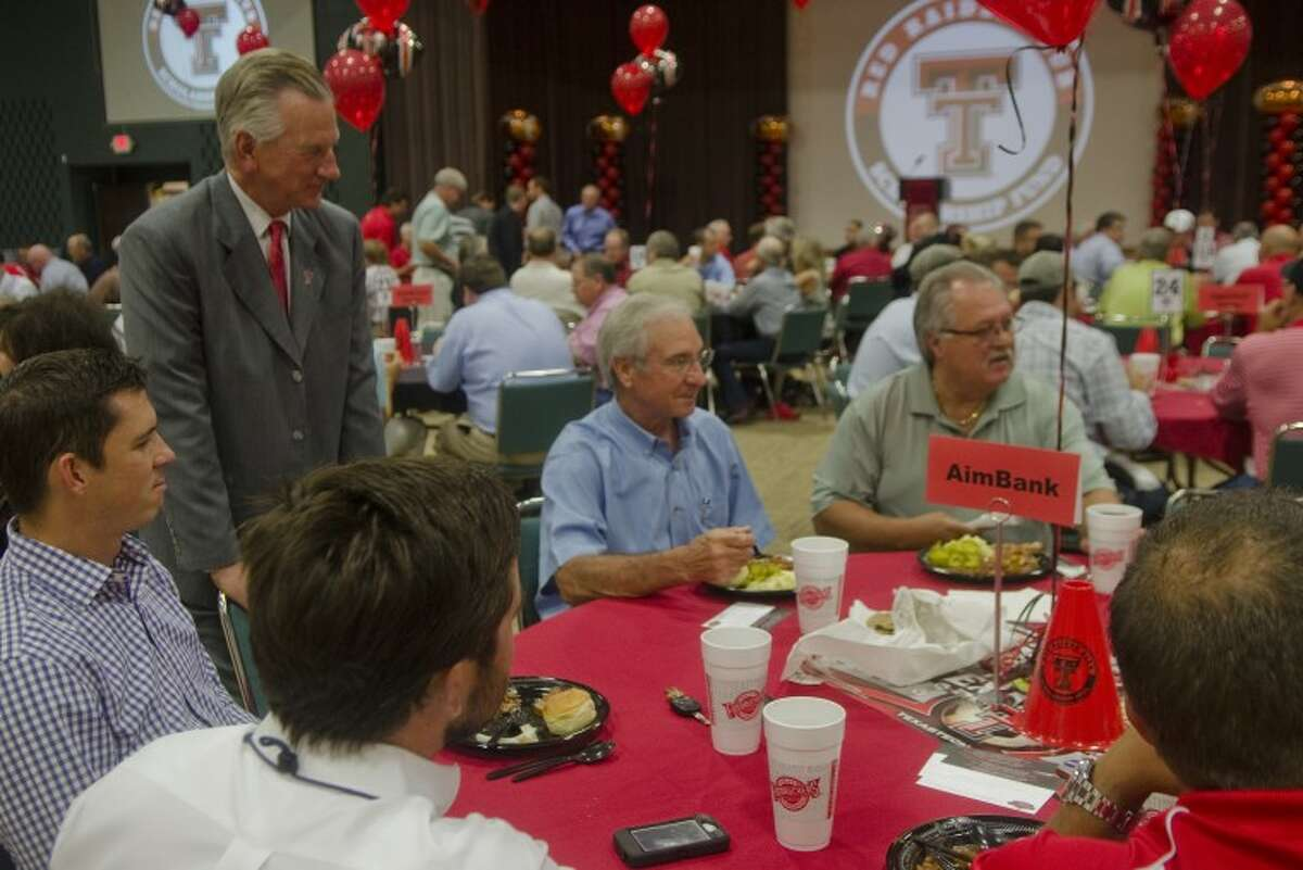 Texas Tech head football coach Tommy Tuberville greets and talks with area alumni Monday at a scholarship luncheon at the Midland Center. Tim Fischer/Reporter-Telegram