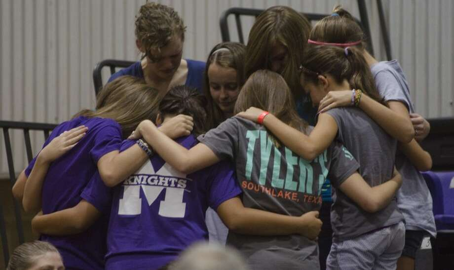 Midland Classical students gather in prayer Saturday evening following a ceremony in the gym to remember and mourn their classmates. Tim Fischer/Reporter-Telegram Photo: Tim Fischer