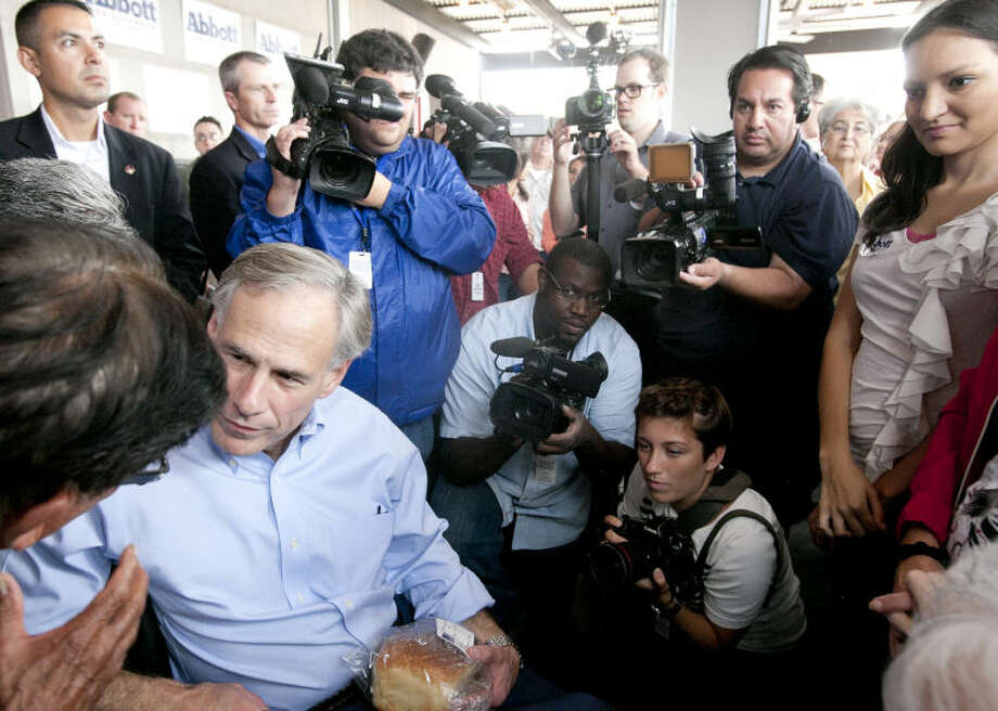 Attorney General Greg Abbott greets supporters after a press conference Wednesday at Basin Burger House where he announced his intention to run for Governor of Texas. James Durbin/Reporter-Telegram Photo: JAMES DURBIN