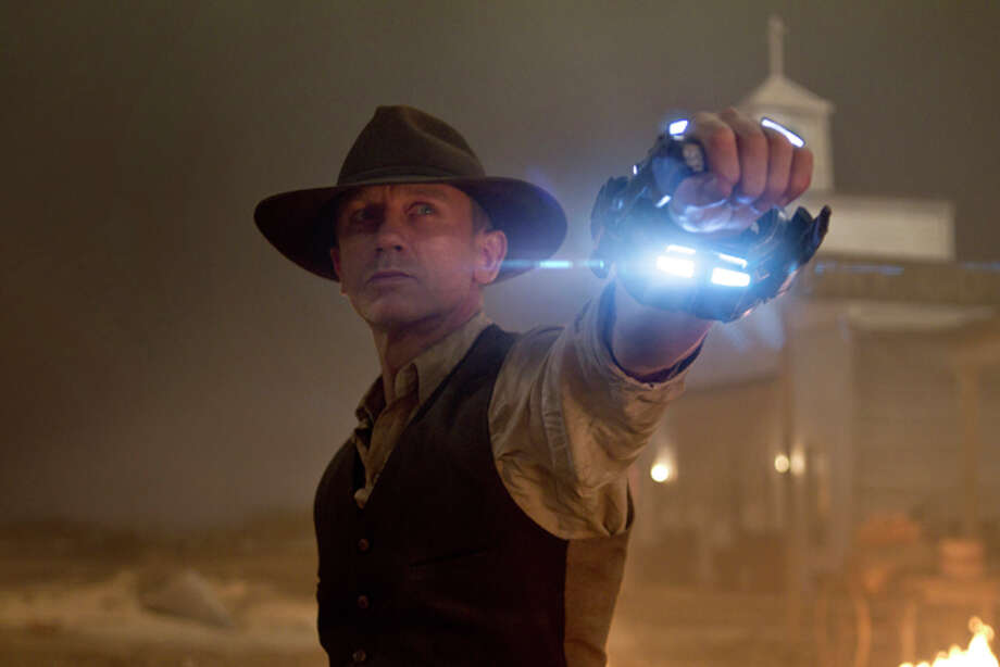 "In this publicity image released by Universal Pictures, Daniel Craig is shown in a scene from ""Cowboys & Aliens."" (AP Photo/Universal Pictures, Timothy White) Photo: Timothy White / Universal Studios and DreamWorks II Distribution Co. LLC Universal Studios and DreamWorks II Distribution Co. LLC"
