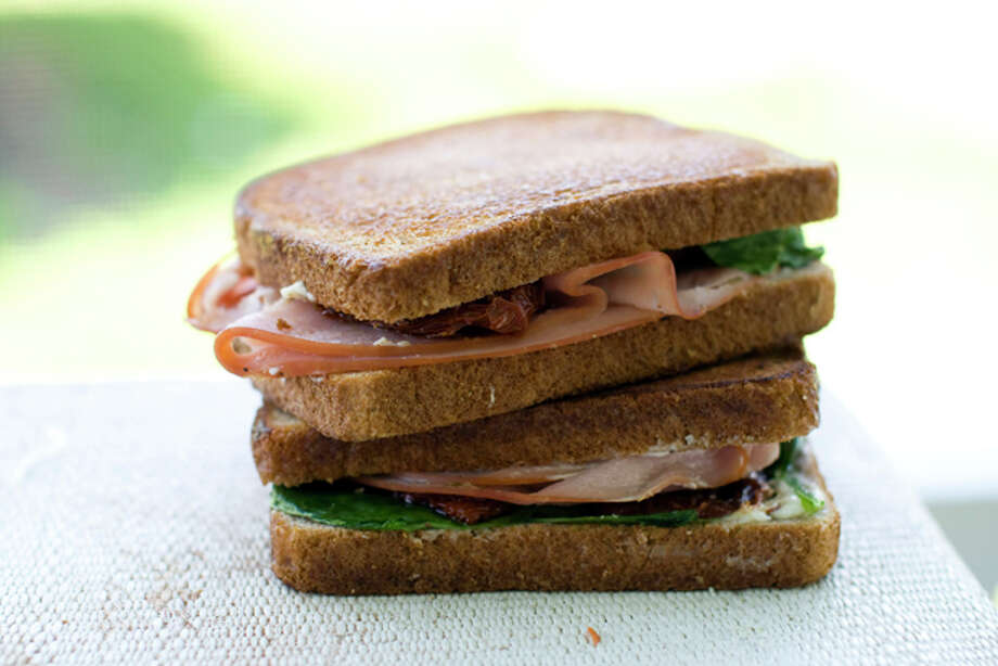 This July 6, 2011 photo shows ham and cheese with sun-dried tomatoes in Concord, N.H. Toasting this sandwich adds a pleasant crunch that is nice even when the sandwich isn't warm. (AP Photo/Matthew Mead) Photo: Matthew Mead / ap